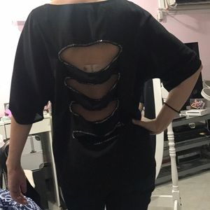 Black blouse with cut out slits on the back